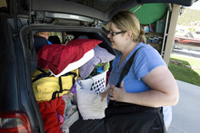 Paul Fraughton  |  The Salt Lake Tribune Lisel Christiansen packs her van Friday, June 22, 2012, with items as she prepares to leave her home in Eagle Mountain. Her neighborhood  was ordered to evacuate as a wildfire came closer to homes in the area.