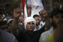 An Egyptian man gestures during a protest in Tahrir Square in Cairo, Egypt, Friday, June 21, 2012. Tens of thousands of Egyptians have converged on Tahrir Square in Cairo to protest against the ruling military council's power grab and in support of the Islamist presidential candidate who they believe won the election. (AP Photo/Manu Brabo)