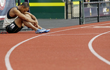 Bryan Clay reacts after the 110m hurdles during the decathlon competition at the U.S. Olympic Track and Field Trials Saturday, June 23, 2012, in Eugene, Ore. (AP Photo/Morry Gash)