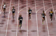 Sanya Richards-Ross leads the way in the women's 400m preliminary at the U.S. Olympic Track and Field Trials Friday, June 22, 2012, in Eugene, Ore. (AP Photo/Marcio Jose Sanchez)