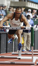 Bryan Clay pushes over a hurdle during the 100m hurdles in the decathlon competition at the U.S. Olympic Track and Field Trials Saturday, June 23, 2012, in Eugene, Ore. (AP Photo/Morry Gash)