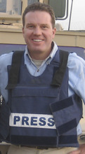 This picture taken on Sept. 20, 2007, and released on Saturday, June 22, 2012 by Gregory Joseph Burke shows Gregory Joseph Burke as a Fox News journalist in the U.S. base of Camp Spann in Afghanistan. Greg Burke, 52, will leave Fox to become a senior communications adviser in the Vatican's secretariat of state, the Vatican and Burke told the AP. The Vatican spokesman, the Rev. Federico Lombardi said Burke will help integrate communications issues within the Vatican's top administrative office, the secretariat of state, and will help handle its relations with the Holy See press office and other Vatican communications offices. (AP Photo)