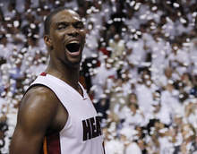 Miami Heat power forward Chris Bosh (1) reacts after Game 5 of the NBA finals basketball seriesagainst the Oklahoma City Thunder, Thursday, June 21, 2012, in Miami. The Heat won 121-106 to become the 2012 NBA Champions.(AP Photo/Lynne Sladky)