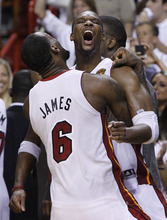 Miami Heat small forward LeBron James (6) and power forward Chris Bosh (1) react in the final moments during the second half at  Game 5 of the NBA finals basketball series, Thursday, June 21, 2012, in Miami. The Heat won 121-106 to become the 2012 NBA Champions.(AP Photo/Lynne Sladky)