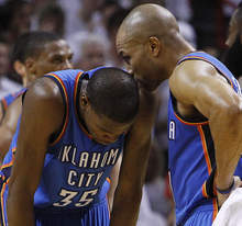 Oklahoma City Thunder point guard Derek Fisher (37) talks to small forward Kevin Durant (35) between plays against the Miami Heat during the second half at  Game 5 of the NBA finals basketball series, Thursday, June 21, 2012, in Miami. (AP Photo/Lynne Sladky)