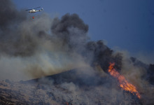 Kim Raff | The Salt Lake Tribune Helicopters try to contain the Dump Wildfire in Saratoga Springs-Eagle Mountain area in Eagle Mountain, Utah on June 23, 2012.