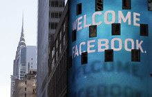 FILE- In this Friday, May 18, 2012, file photo, the animated facade of the Nasdaq MarketSite, welcomes the Facebook IPO, in New York's Times Square. It's been a month since Facebook's IPO fell flat and in that time, the market for initial public offerings has gone cold. Venture capitalists say the fallout from Facebook's rocky IPO is making technology companies more cautious about going public. (AP Photo/Richard Drew, File)