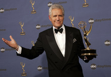 FILE- In this Friday, April 28, 2006, file photo, Alex Trebek holds the award for outstanding game show host, for his work on