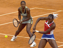 Venus Williams of the U.S., right, and her sister Serena Williams play in the women doubles' final against Martina Hingis of Switzerland and Anna Kournikova of Russia at the French Open tennis tournament at Roland Garros stadium in Paris Sunday, June 6, 1999. (AP Photo/Michel Euler)