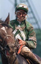 Jockey Julie Krone is covered with mud after a race at Monmouth Park in Oceanport, N.J., in July 1987.  (AP Photo/Susan Ragan)