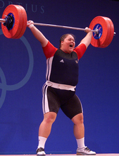 USA's Cheryl Haworth, age 17, raises barbells over her head in the snatch event of  the women's over-75 kg weightlifting event at the Summer Olympic Games in Sydney Friday Sept. 22, 2000. (AP Photo/David Guttenfelder)