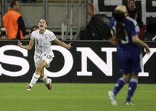 United States' Alex Morgan celebrates scoring the opening goal, as Japan's Homare Sawa, right, reacts during the final match between Japan and the United States at the Women's Soccer World Cup in Frankfurt, Germany, Sunday, July 17, 2011. (AP Photo/Frank Augstein)