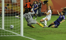 United States' Alex Morgan, center, fails to score past Japan goalkeeper Ayumi Kaihori during the final match between Japan and the United States at the Women's Soccer World Cup in Frankfurt, Germany, Sunday, July 17, 2011. (AP Photo/Martin Meissner)