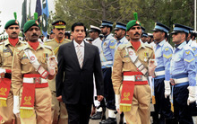 In this photo released by Pakistan's Press Information Department, Pakistan's newly elected Prime Minister Raja Pervaiz Ashraf, center, reviews the honor guard at the Prime Minister's residence in Islamabad, Pakistan on Saturday, June 23, 2012. Pakistani lawmakers elected a ruling party loyalist as the new prime minister, despite corruption allegations and his failure to end the country's energy crisis setting in motion what is likely to be a short and turbulent premiership. (AP Photo/Press Information Department)