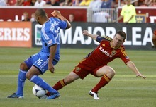 San Jose Earthquakes defender Victor Bernardez strips the ball from Real Salt Lake midfielder Will Johnson in the first half at Rio Tinto Stadium in Sandy, Utah. Stephen Holt / Special to the tribune