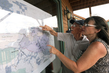 Ken and Dottie Wanberg inspect a map as they try to gather news of their second home, which is located inside an evacuated area in the Glacier View subdivision, on Sunday, June 24, 2012, outside The Forks in Livermore, Colo. With eight wildfires burning, including a fire that has scorched more than 118 square miles and destroyed at least 191 homes near Fort Collins, Colorado is having its worst wildfire season in a decade. (AP Photo/The Coloradoan, Dawn Madura) NO SALES