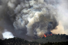 Flames erupt on a ridge above the Cedar Heights neighborhood in Colorado Springs, Colo. Sunday, June 24, 2012. A wildfire near Colorado Springs erupted and grew out of control to more than 3 square miles early Sunday, prompting the evacuation of residents and an unknown number of tourists. (AP Photo/The Denver Post, Helen H. Richardson)