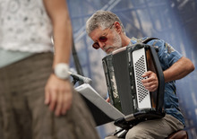 Michael Mangum  |  Special to the Tribune  Steve Keen plays the accordion in a group performance of the Salt Lake City-based celtic fusion band named Stonecircle at the Utah Arts Festival in downtown Salt Lake City on Sunday, June 24, 2012.