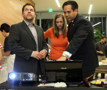 AG candidate, Sean Reyes (right), Saysha Reyes (wife) and Michael Deaver (left) look at the election results just before conceding to John Swallow on election night.  June 26, 2012.  (Michael Brandy, Special to the Tribune).