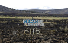 Al Hartmann  |  The Salt Lake Tribune   Love note on fence is the only color along a burned out area along U.S. Highway 89 near Indianola.  The area burned Sunday in the Wood Hollow fire.