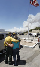 Al Hartmann     The Salt Lake Tribune   Janice Taylor gets a hug of comfort from Indianola Fire Chief Kent Higgins as they watch the Wood Hollow fire flare up Tuesday, June 26, 2012, afternoon due to high winds.  The fire closed U.S Highway 89 further to the north about 2:30.  Janice Taylor and her husband David lost their home to the fire on Sunday.
