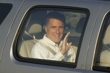 Republican Presidential candidate Mitt Romney waves as he arrives at the Utah Olympic Park for a private dinner during a donor's conference in Park City, Utah, Friday, June 22, 2012. (AP Photo/Charles Dharapak)