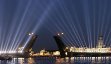The Dvortsovy drawbridge is illuminated as it is raised across the Neva River during White Nights in St. Petersburg, Russia, early Saturday, June 23, 2012. White Nights, where it never truly gets dark, last for about a month from the middle of June till the middle of July. (AP Photo/Dmitry Lovetsky)