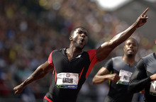 Justin Gatlin reacts after winning the men's 100m finals at the U.S. Olympic Track and Field Trials Sunday, June 24, 2012, in Eugene, Ore. (AP Photo/Marcio Jose Sanchez)