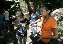 Francisco Kjolseth  |  The Salt Lake Tribune Selena Charles, 13, Audrey Overly, 13, and Erin Todachinnie, from left, test the Ph balance in Emigration Creek during a science camp on Tuesday, June 26, 2012. Selena and Erin, who are both from the Navajo Nation in Shipwreck N.M., joined other students at Westminster college for a fun and educational summer camp this week for girls entering the 8th grade. The AWE+SUM camp is designed specifically to get girls interested in math and science, with a three day run from Monday to Wednesday of this week.