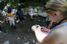 Francisco Kjolseth  |  The Salt Lake Tribune Evanny Schaffer, 13, of Murray writes down the results of organisms found in Emigration Creek as Westminster college hosts asummer camp for girls entering  8th grade. The AWE+SUM camp is designed specifically to get girls interested in math and science.