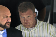 FILE - In this June 20, 2012 file photo, Matt Sandusky, right, adopted son of former Penn State assistant coach Jerry Sandusky, leaves the Centre County Courthouse in Bellefonte, Pa., where his father was being tried on charges of child sexual abuse involving 10 boys over a period of 15 years. Matt Sandusky, who released a statement on June 22, 2012 that his father had sexually abused him as well, describes being abused as an 8-year-old boy by his father on a police interview tape obtained by NBC News. (AP Photo/Gene J. Puskar, File)