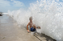 Maxi Kluzek, 8, enjoys the rough wether as waves slam into the seawall in Pass-a-Grille, Fla., Monday, June 25, 2012.   A tropical storm warning is in effect the west coast of Florida Monday, including the Tampa Bay area, as Tropical Storm Debby began showing a movement to the northeast. (AP Photo/Tampa Tribune, Jason Behnken)   ST. PETERSBURG OUT; LAKELAND OUT; BRADENTON OUT; MAGS OUT; LOCAL TV OUT; WTSP CH 10 OUT; WFTS CH 28 OUT; WTVT CH 13 OUT; BAYNEWS 9 OUT