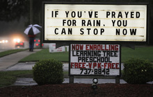 A message referring to rainfall from a tropical storm system is displayed at the San Jose Baptist Church on Monday, June 25, 2012, in Jacksonville, Fla.  Tropical Storm Debby raked the Tampa Bay area with high wind and heavy rain Monday in a drenching that could top 2 feet over the next few days and trigger widespread flooding. (AP Photo/The Florida Times-Union, Kelly Jordan)