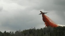 An air tanker dumps a load of fire retardant on the Wood Hollow fire, which had neared 40,000 acres in central Utah's Sanpete County on Tuesday. (Interagency Fire Center photo)
