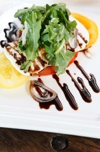 Trent Nelson  |  The Salt Lake Tribune Heirloom tomatoes (with house mozzarella, arugula, shallot, balsamic vinegar) at the restaurant Pallet in Salt Lake City.