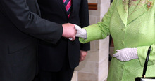 Britain's Queen Elizabeth II shakes hands with Northern Ireland Deputy First Minister and former IRA commander Martin McGuinness at the Lyric Theatre in Belfast, Northern Ireland, Wednesday, June 27, 2012. (AP Photo/Paul Faith/pool)