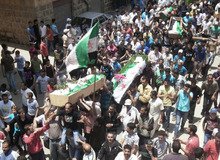 This citizen journalism image provided by Shaam News Network SNN, purports to show anti-Syrian regime mourners carrying the coffins of Syrian citizens wrapped with Syrian revolutionary flags who were killed by the Syrian forces shelling, in Daraa, southern Syria, Tuesday June 26, 2012. Syria's elite Republican Guard forces clashed with rebels just outside Damascus Tuesday in some of the most intense fighting involving the special forces guarding the capital since an uprising against President Bashar Assad's regime began last year, activists said. (AP Photo/Shaam News Network, SNN)THE ASSOCIATED PRESS IS UNABLE TO INDEPENDENTLY VERIFY THE AUTHENTICITY, CONTENT, LOCATION OR DATE OF THIS HANDOUT PHOTO