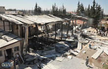 In this photo released by the Syrian official news agency, SANA, the damaged Ikhbariya TV compound is seen after it was attacked by gunmen, in in the town of Drousha, about 20 kilometers (14 miles) south of Damascus, Syria, Wednesday, June 27, 2012. Gunmen raided the headquarters of a pro-government Syrian TV station early Wednesday, demolishing the building and killing three employees, the state media reported. Syrian officials denounced what they called a rebel