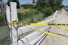 Lennie Mahler  |  The Salt Lake Tribune A West Jordan canal flows downstream from where the body of a 6-year-old girl was found Tuesday, June 26, 2012.