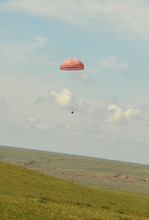 This photo released by China's Xinhua News Agency shows the re-entry capsule of China's Shenzhou 9 spacecraft touching down in Siziwang Banner of north China's Inner Mongolia Autonomous Region Friday, June 29, 2012. The Chinese space capsule with three astronauts aboard returned Friday from a 13-day mission to an orbiting module that is a prototype for a future permanent station. (AP Photo/Xinhua, Ren Junchuan) NO SALES