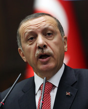 In this photo taken Tuesday, June 26, 2012 Turkish Prime Minister Recep Tayyip Erdogan addresses his lawmakers in Ankara, Turkey. Erdogan kept up his pressure on Syria on Wednesday, saying