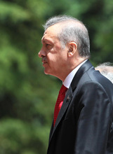 Turkish Prime Minister Recep Tayyip Erdogan arrives for a cabinet meeting in his office in Ankara, Turkey, Monday, June 25, 2012. Upon Turkey's request, NATO will hold a meeting Tuesday in Brussels over article 4 of its charter concerning Friday's incident, when a Turkish warplane was shot down by Syria. Syria's Foreign Ministry spokesman Jihad Makdissi said Monday his country has