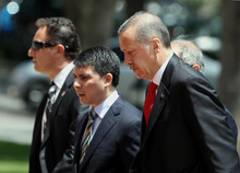 Turkish Prime Minister Recep Tayyip Erdogan, right, arrives for a cabinet meeting in his office in Ankara, Turkey, Monday, June 25, 2012. Upon Turkey's request, NATO will hold a meeting Tuesday in Brussels over article 4 of its charter concerning Friday's incident, when a Turkish warplane was shot down by Syria. Syria's Foreign Ministry spokesman Jihad Makdissi said Monday his country has