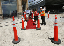 Scott Sommerdorf  |  The Salt Lake Tribune              The red carpet was rolled out amidst the construction site as The Outlets at Traverse Mountain announced an expansion and new retailers, Thursday, June 28, 2012.