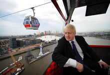 London Mayor Boris Johnson takes one of the first rides on the Emirates Air Line cable car across the River Thames in London prior to its official opening to the public this morning, Thursday, June 28, 2012. Each car provides 360-degree views taking in the City, Canary Wharf, historic Greenwich, the Thames Barrier and the Olympic Park. (AP Photo/Stefan Rousseau/PA) UNITED KINGDOM OUT  NO SALES  NO ARCHIVE