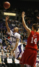 Steve Griffin  |  The Salt Lake Tribune  Ogden -  Weber State's Damian Lillard scopes in two over Utah's Kim Tillie during first half action of the their basketball game at the Dee Events Center in Ogden Wednesday Dec 2, 2009,