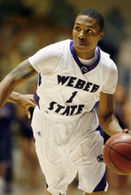Steve Griffin  |  The Salt Lake Tribune  Ogden -  Weber State's Damian Lillard jumps drives the ball to the basket late in the second half  of the their basketball game at the Dee Events Center in Ogden Wednesday Dec 2, 2009,