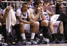Weber's fouled out Daviin Davis (head covered) and Damian Lillard react with Steve Panos and Darin Mahoney.  Weber was defeated by Montana State 70-61. Weber State University played Montana State Tuesday in the Big Sky Conference semifinals. Photo by Leah Hogsten/ The Salt Lake Tribune Ogden 3/10/09