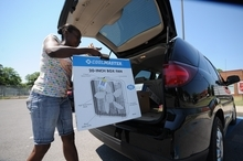 Delores Smith loads a donated fan for her mother outside the Salvation Army Social Services building in Chattanooga, Tenn., Wednesday, June 27, 2012. Temperatures are expected to reach record levels by the weekend. (AP Photo/Chattanooga Times Free Press, Tim  Barber)