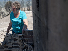 Michael Mangum  |  Special to the Tribune  Indianola resident Janice Taylor surverys the rubble of her home on Wednesday, June 27, 2012. Taylor's home had been completely destroyed when the Wood Hollow wildfire ripped through the area, destroying everything on her property.